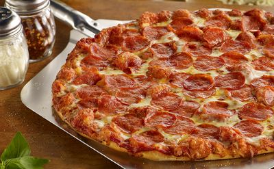 Buy a Large Pizza, Chicken & Mojos Combo and Get a Medium 1 Topping Pizza for $5.99 at Shakey's Pizza